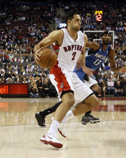 Oct 9, 2013; Toronto, Ontario, CAN; Toronto Raptors guard Landry Fields (2) carries the ball against the Minnesota Timberwolves at the Air Canada Centre. Minnesota defeated Toronto 101-89. Mandatory Credit: John E. Sokolowski-USA TODAY Sports