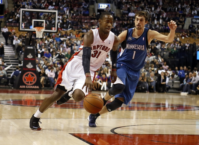 Oct 9, 2013; Toronto, Ontario, CAN; Toronto Raptors guard Terrence Ross (31) carries the ball past Minnesota Timberwolves guard Alexey Shved (1) at the Air Canada Centre. Minnesota defeated Toronto 101-89. Mandatory Credit: John E. Sokolowski-USA TODAY Sports