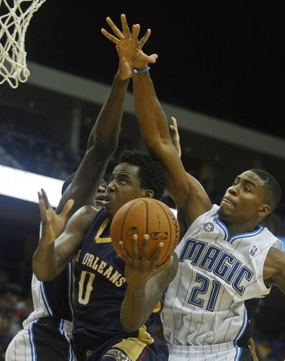 Oct 9, 2013; Jacksonville, FL, USA; Orlando Magic forward Maurice Harkless (21) goes up to block a layup by New Orleans Pelicans forward Al-Farouq Aminu (0) in the second half of their game at Jacksonville Veterans Memorial Arena. The New Orleans Pelicans beat the Orlando Magic 99-95. Mandatory Credit: Phil Sears-USA TODAY Sports