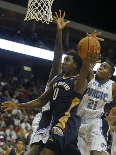 Oct 9, 2013; Jacksonville, FL, USA; Orlando Magic forward Maurice Harkless (21) blocks a layup by New Orleans Pelicans forward Al-Farouq Aminu (0) in the second half of their game at Jacksonville Veterans Memorial Arena. The New Orleans Pelicans beat the Orlando Magic 99-95. Mandatory Credit: Phil Sears-USA TODAY Sports