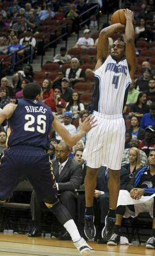 Oct 9, 2013; Jacksonville, FL, USA; Orlando Magic guard/forward Arron Afflalo (4) shoots over New Orleans Pelicans guard Austin Rivers (25) in the second half of their game at Jacksonville Veterans Memorial Arena. The New Orleans Pelicans beat the Orlando Magic 99-95. Mandatory Credit: Phil Sears-USA TODAY Sports