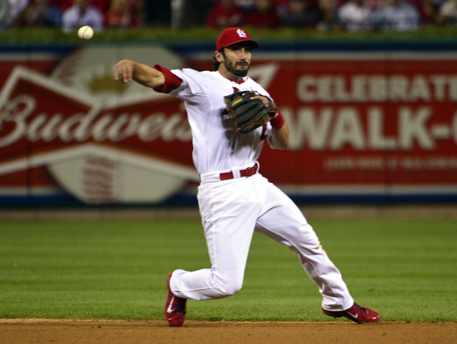 Oct 9, 2013; St. Louis, MO, USA; St. Louis Cardinals second baseman Matt Carpenter (13) throws to first base against the Pittsburgh Pirates in game five of the National League divisional series playoff baseball game at Busch Stadium. Mandatory Credit: Scott Rovak-USA TODAY Sports