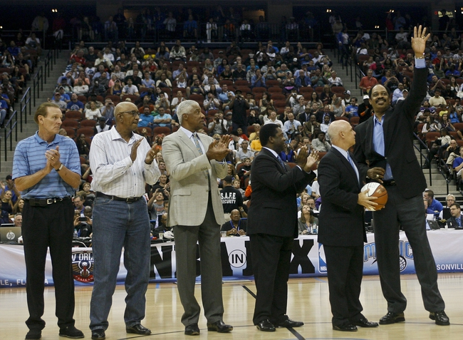 Oct 9, 2013; Jacksonville, FL, USA; NBA legend Artis Gilmore (right) is recognized during a break  in the second half of the Orlando Magic game against the New Orleans Pelicans at Jacksonville Veterans Memorial Arena. Other NBA legends include, from left, Rick Barry, and George Gervin and Julius Erving. The New Orleans Pelicans beat the Orlando Magic 99-95. Mandatory Credit: Phil Sears-USA TODAY Sports