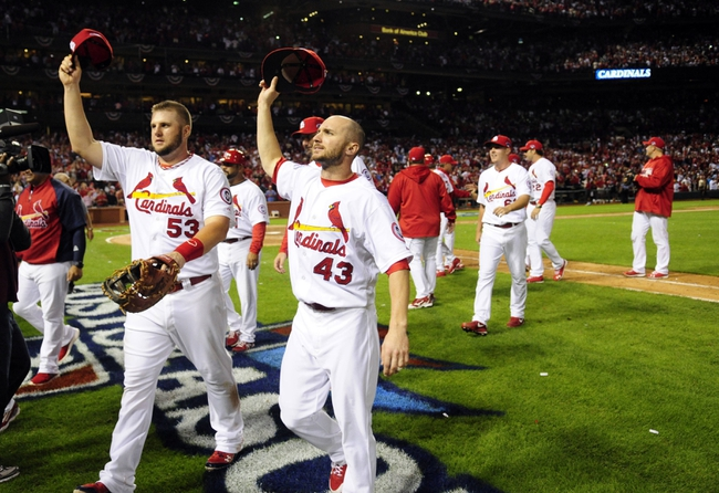 Oct 9, 2013; St. Louis, MO, USA; St. Louis Cardinals first baseman Matt Adams (53) and right fielder Shane Robinson (43) wave to fans after game five of the National League divisional series playoff baseball game at Busch Stadium. The Cardinals won 6-1. Mandatory Credit: Jeff Curry-USA TODAY Sports