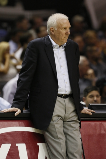 Oct 9, 2013; San Antonio, TX, USA; San Antonio Spurs head coach Gregg Popovich watches from the sideline during the second half agains the CSKA Moscow at the AT&T Center. The Spurs won 95-93 in overtime. Mandatory Credit: Soobum Im-USA TODAY Sports