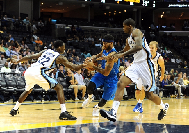 Oct 9, 2013; Memphis, TN, USA; Dallas Mavericks shooting guard D.J. Kennedy (12) drives to the basket against Memphis Grizzlies shooting guard Jamaal Franklin (22) in the fourth quarter at FedExForum.Dallas Mavericks defeated Memphis Grizzlies 95-90.  Mandatory Credit: Justin Ford-USA TODAY Sports