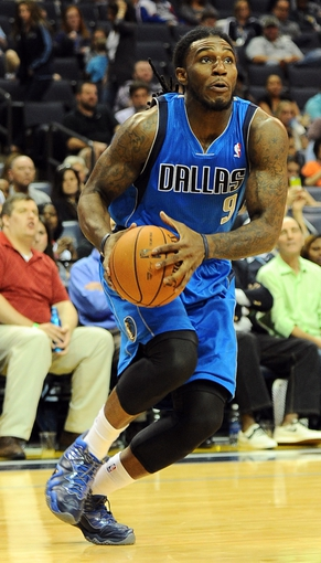Oct 9, 2013; Memphis, TN, USA; Dallas Mavericks small forward Jae Crowder (9) goes for a lay up against the Memphis Grizzlies in the fourth quarter at FedExForum. Dallas Mavericks defeated Memphis Grizzlies 95-90. Mandatory Credit: Justin Ford-USA TODAY Sports