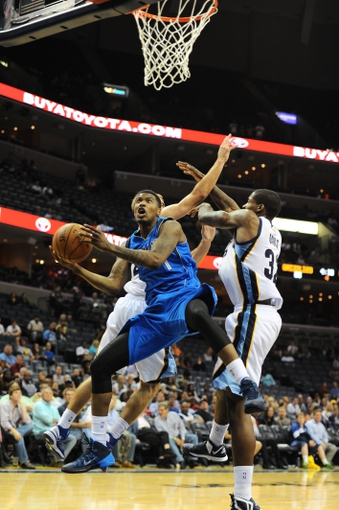 Oct 9, 2013; Memphis, TN, USA; Dallas Mavericks shooting guard Ricky Ledo (7) lays the ball up against Memphis Grizzlies in the fourth at FedExForum. Dallas Mavericks defeated Memphis Grizzlies 95-90. Mandatory Credit: Justin Ford-USA TODAY Sports