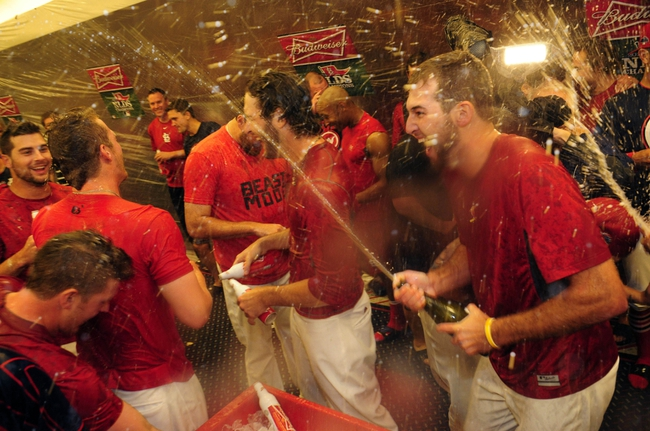 Oct 9, 2013; St. Louis, MO, USA; St. Louis Cardinals starting pitcher Michael Wacha (right) celebrates with teammates after game five of the National League divisional series playoff baseball game against the Pittsburgh Pirates at Busch Stadium. The Cardinals won 6-1. Mandatory Credit: Jeff Curry-USA TODAY Sports