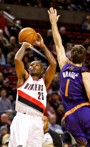 Oct 9, 2013; Portland, OR, USA; Portland Trail Blazers point guard Mo Williams (25) shoots over Phoenix Suns point guard Goran Dragic (1) at the Moda Center. Mandatory Credit: Craig Mitchelldyer-USA TODAY Sports