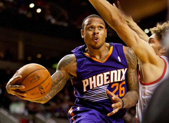 Oct 9, 2013; Portland, OR, USA; Phoenix Suns point guard Shannon Brown (26) drives to the basket past Portland Trail Blazers center Robin Lopez (42) at the Moda Center. Mandatory Credit: Craig Mitchelldyer-USA TODAY Sports