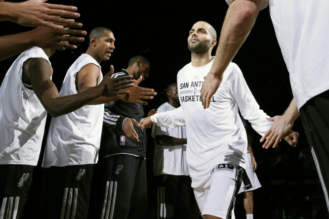 Oct 9, 2013; San Antonio, TX, USA; San Antonio Spurs guard Tony Parker (9) is introduced before the game against the CSKA Moscow at the AT&T Center. Mandatory Credit: Soobum Im-USA TODAY Sports