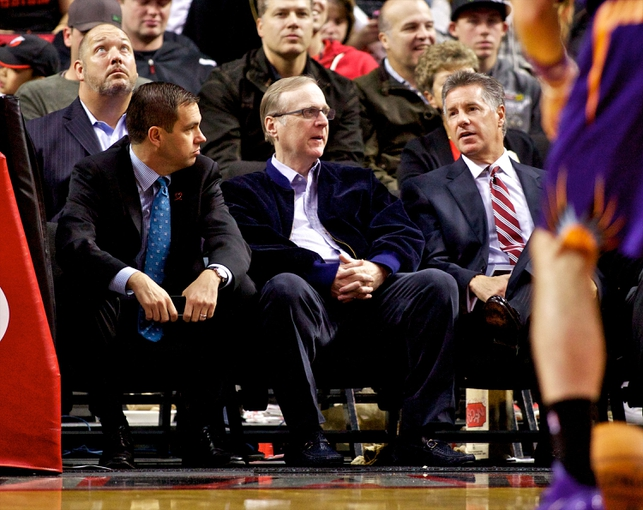 Oct 9, 2013; Portland, OR, USA; Portland Trail Blazers president Chris McGowan, owner Paul Allen, and general manager Neil Olshey talk during a free throw at the Moda Center. Mandatory Credit: Craig Mitchelldyer-USA TODAY Sports