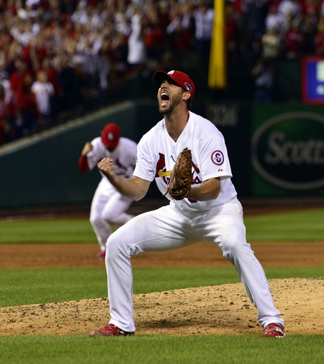 Oct 9, 2013; St. Louis, MO, USA; St. Louis Cardinals starting pitcher Adam Wainwright (50) celebrates after defeating the Pittsburgh Pirates in game five of the National League divisional series playoff baseball game at Busch Stadium. The Cardinals won 6-1. Mandatory Credit: Scott Rovak-USA TODAY Sports