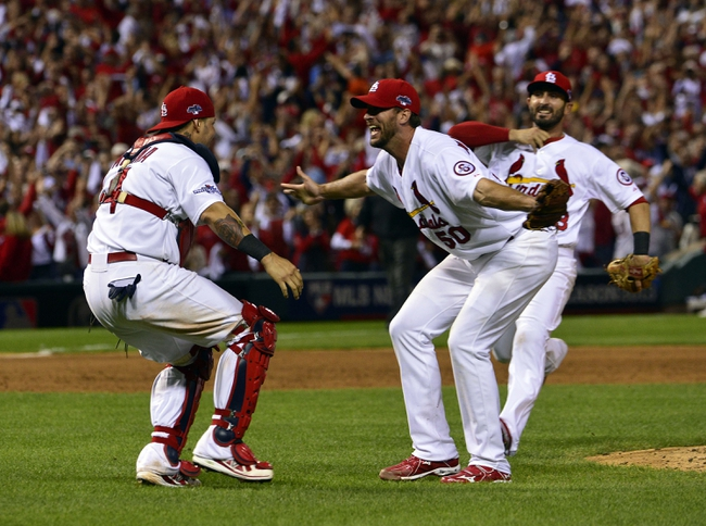 Oct 9, 2013; St. Louis, MO, USA; St. Louis Cardinals starting pitcher Adam Wainwright (50) celebrates with catcher Yadier Molina (4) after defeating the Pittsburgh Pirates in game five of the National League divisional series playoff baseball game at Busch Stadium. The Cardinals won 6-1. Mandatory Credit: Scott Rovak-USA TODAY Sports