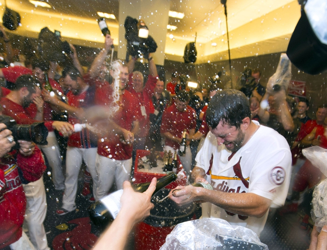 Oct 9, 2013; St. Louis, MO, USA; St. Louis Cardinals starting pitcher Adam Wainwright (50) celebrates with teammates after defeating the Pittsburgh Pirates in game five of the National League divisional series playoff baseball game at Busch Stadium. The Cardinals won 6-1. Mandatory Credit: Scott Rovak-USA TODAY Sports