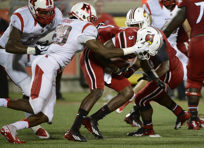 Oct 10, 2013; Louisville, KY, USA; Rutgers Scarlet Knights defensive back Davon Jacobs (29) sacks Louisville Cardinals quarterback Teddy Bridgewater (5) during the first quarter at Papa John's Cardinal Stadium. Mandatory Credit: Jamie Rhodes-USA TODAY Sports
