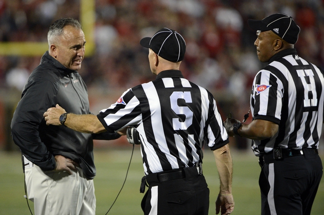 Oct 10, 2013; Louisville, KY, USA; Rutgers Scarlet Knights head coach Kyle Flood questions the officials about a call during the second quarter against the Louisville Cardinals at Papa John's Cardinal Stadium. Mandatory Credit: Jamie Rhodes-USA TODAY Sports