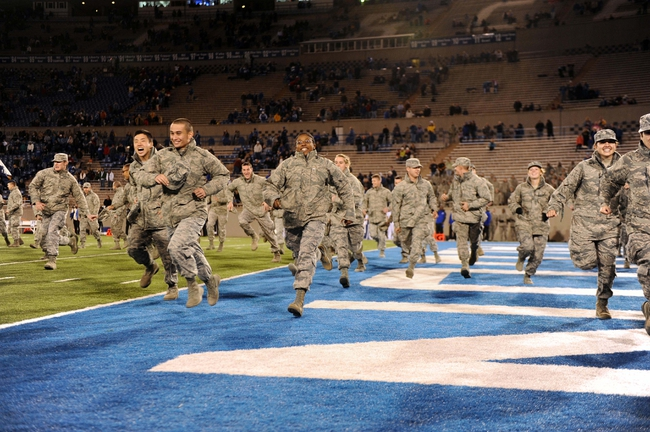 Oct 10, 2013; Colorado Springs, CO, USA; Air Force Falcons cadets run off the field before the game against the San Diego State Aztecs at Falcon Stadium. Mandatory Credit: Ron Chenoy-USA TODAY Sports