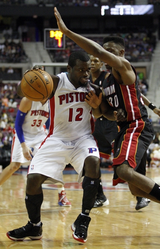 Oct 10, 2013; Auburn Hills, MI, USA; Detroit Pistons point guard Will Bynum (12) defended by Miami Heat point guard Norris Cole (30) during the third quarter at The Palace of Auburn Hills. Heat beat the Pistons 112-107. Mandatory Credit: Raj Mehta-USA TODAY Sports