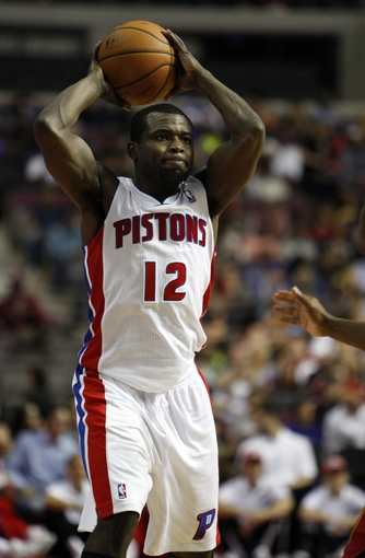 Oct 10, 2013; Auburn Hills, MI, USA; Detroit Pistons point guard Will Bynum (12) holds the ball over his head during the third quarter against the Miami Heat at The Palace of Auburn Hills. Heat beat the Pistons 112-107. Mandatory Credit: Raj Mehta-USA TODAY Sports