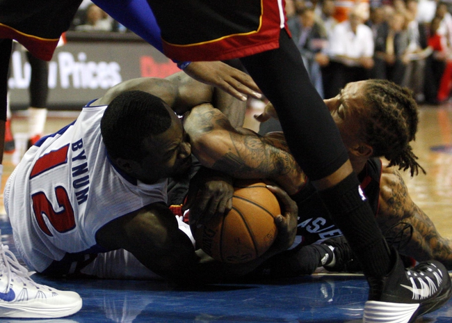 Oct 10, 2013; Auburn Hills, MI, USA; Detroit Pistons point guard Will Bynum (12) and Miami Heat small forward Michael Beasley (8) fight for the ball during the third quarter at The Palace of Auburn Hills. Heat beat the Pistons 112-107. Mandatory Credit: Raj Mehta-USA TODAY Sports