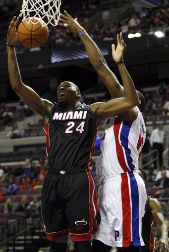 Oct 10, 2013; Auburn Hills, MI, USA; Miami Heat power forward Jarvis Varnado (24) gets a rebound during the third quarter against the Detroit Pistons at The Palace of Auburn Hills. Heat beat the Pistons 112-107. Mandatory Credit: Raj Mehta-USA TODAY Sports