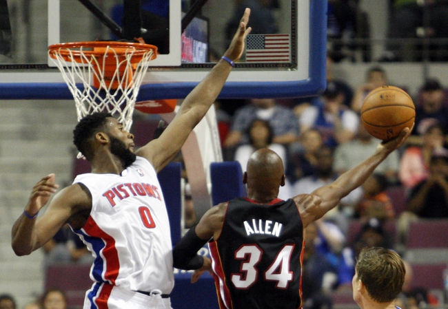 Oct 10, 2013; Auburn Hills, MI, USA; Miami Heat shooting guard Ray Allen (34) attempts a lay up against Detroit Pistons center Andre Drummond (0) during the fourth quarter at The Palace of Auburn Hills. Heat beat the Pistons 112-107. Mandatory Credit: Raj Mehta-USA TODAY Sports