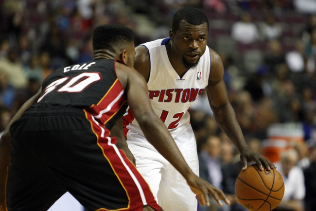 Oct 10, 2013; Auburn Hills, MI, USA; Detroit Pistons point guard Will Bynum (12) defended by Miami Heat point guard Norris Cole (30) during the fourth quarter at The Palace of Auburn Hills. Heat beat the Pistons 112-107. Mandatory Credit: Raj Mehta-USA TODAY Sports