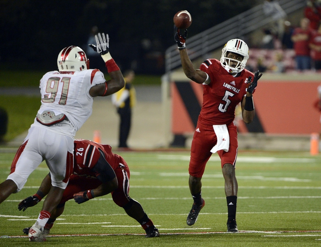 Oct 10, 2013; Louisville, KY, USA; Louisville Cardinals quarterback Teddy Bridgewater (5) throws a pass against the Rutgers Scarlet Knights during the second half at Papa John's Cardinal Stadium. Louisville defeated Rutgers 24-10.  Mandatory Credit: Jamie Rhodes-USA TODAY Sports