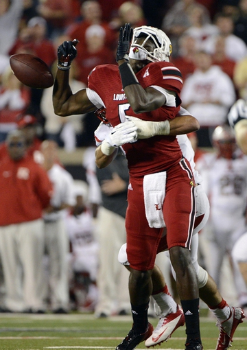 Oct 10, 2013; Louisville, KY, USA; Rutgers Scarlet Knights defensive back Anthony Cioffi (31) sacks Louisville Cardinals quarterback Teddy Bridgewater (5) during the second half at Papa John's Cardinal Stadium. Louisville defeated Rutgers 24-10.  Mandatory Credit: Jamie Rhodes-USA TODAY Sports