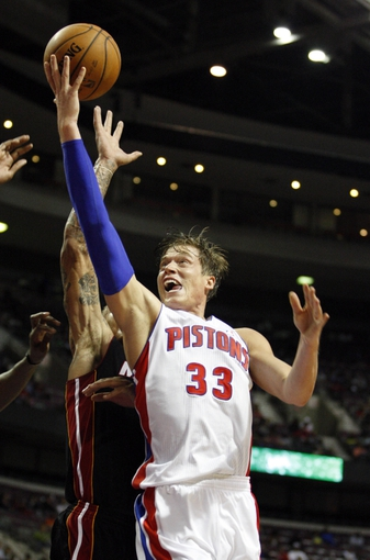 Oct 10, 2013; Auburn Hills, MI, USA; Detroit Pistons power forward Jonas Jerebko (33) attempts a lay in during the fourth quarter against the Miami Heat at The Palace of Auburn Hills. Heat beat the Pistons 112-107. Mandatory Credit: Raj Mehta-USA TODAY Sports