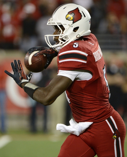 Oct 10, 2013; Louisville, KY, USA; Louisville Cardinals quarterback Teddy Bridgewater (5) looks to pass against the Rutgers Scarlet Knights during the second half at Papa John's Cardinal Stadium. Louisville defeated Rutgers 24-10.  Mandatory Credit: Jamie Rhodes-USA TODAY Sports