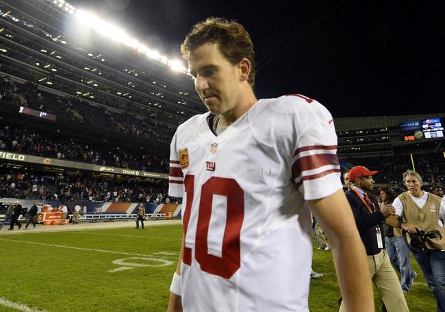 Oct 10, 2013; Chicago, IL, USA; New York Giants quarterback Eli Manning (10) leaves the field after the game against the Chicago Bears at Soldier Field. Chicago defeats New York 27-21. Mandatory Credit: Mike DiNovo-USA TODAY Sports