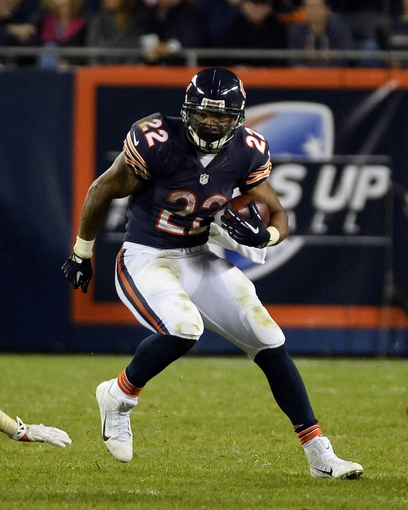 Oct 10, 2013; Chicago, IL, USA; Chicago Bears running back Matt Forte (22) rushes the ball against New York Giants outside linebacker Spencer Paysinger (54) during the second half at Soldier Field. Chicago defeats New York 27-21. Mandatory Credit: Mike DiNovo-USA TODAY Sports