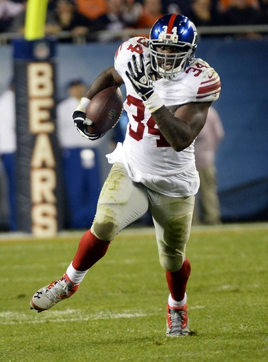 Oct 10, 2013; Chicago, IL, USA; New York Giants running back Brandon Jacobs (34) rushes the ball against the Chicago Bears during the second half at Soldier Field. Chicago defeats New York 27-21. Mandatory Credit: Mike DiNovo-USA TODAY Sports