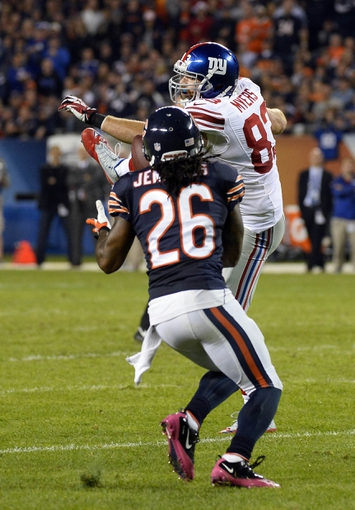 Oct 10, 2013; Chicago, IL, USA; Chicago Bears cornerback Tim Jennings (26) intercepts a pass intended for New York Giants tight end Brandon Myers (83) during the second half at Soldier Field. Chicago defeats New York 27-21. Mandatory Credit: Mike DiNovo-USA TODAY Sports