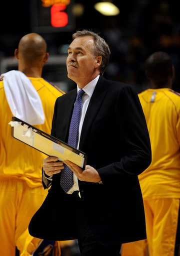 Oct 10, 2013; Las Vegas, NV, USA;  Los Angeles Lakers head coach Mike D'Antoni looks towards the scoreboard during a time out taken from an NBA preseason game against the Sacramento Kings at MGM Grand Arena. Mandatory Credit: Stephen R. Sylvanie-USA TODAY Sports