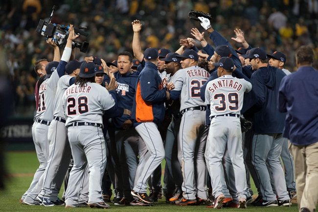Oct 10, 2013; Oakland, CA, USA; The Detroit Tigers celebrate on the field after defeating the Oakland Athletics 3-0 in game five of the American League divisional series playoff baseball game at O.co Coliseum. Mandatory Credit: Ed Szczepanski-USA TODAY Sports