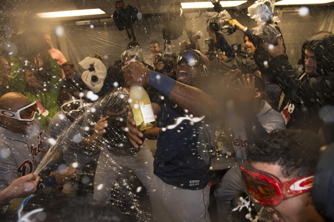 October 10, 2013; Oakland, CA, USA; Detroit Tigers right fielder Torii Hunter (48) celebrates in the clubhouse after game five of the American League divisional series playoff baseball game against the Oakland Athletics at O.co Coliseum. The Tigers defeated the Athletics 3-0. Mandatory Credit: Kyle Terada-USA TODAY Sports