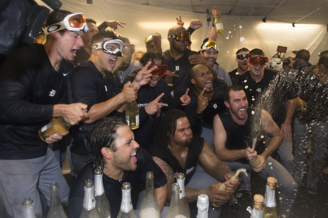 October 10, 2013; Oakland, CA, USA; Detroit Tigers players celebrate in the clubhouse after game five of the American League divisional series playoff baseball game against the Oakland Athletics at O.co Coliseum. The Tigers defeated the Athletics 3-0. Mandatory Credit: Kyle Terada-USA TODAY Sports