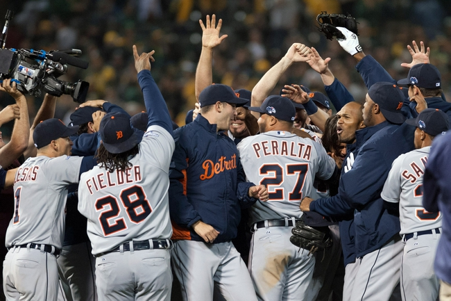 Oct 10, 2013; Oakland, CA, USA;  Detroit Tigers players celebrate their victory over the Oakland Athletics in game five of the American League divisional series playoff baseball game at O.co Coliseum. The Tigers won 3-0. Mandatory Credit: Ed Szczepanski-USA TODAY Sports