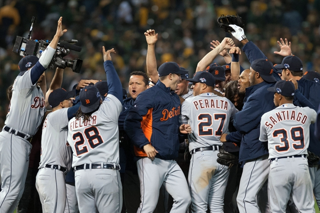 Oct 10, 2013; Oakland, CA, USA;  Detroit Tigers players celebrate their victory over the Oakland Athletics in game five of the American League divisional series playoff baseball game at O.co Coliseum. The Detroit Tigers defeated the Oakland Athletics 3-0. Mandatory Credit: Ed Szczepanski-USA TODAY Sports