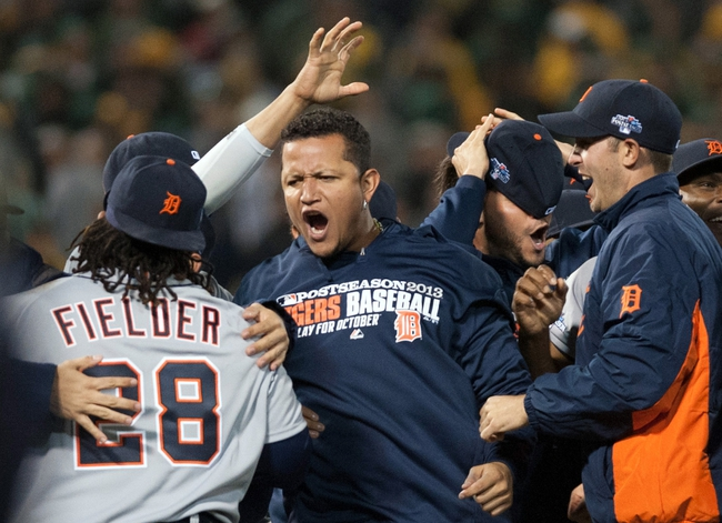 Oct 10, 2013; Oakland, CA, USA; Detroit Tigers third baseman Miguel Cabrera (middle) celebrates with teammates including Prince Fielder (left) after game five of the American League divisional series playoff baseball game against the Oakland Athletics at O.co Coliseum. The Tigers won 3-0. Mandatory Credit: Ed Szczepanski-USA TODAY Sports