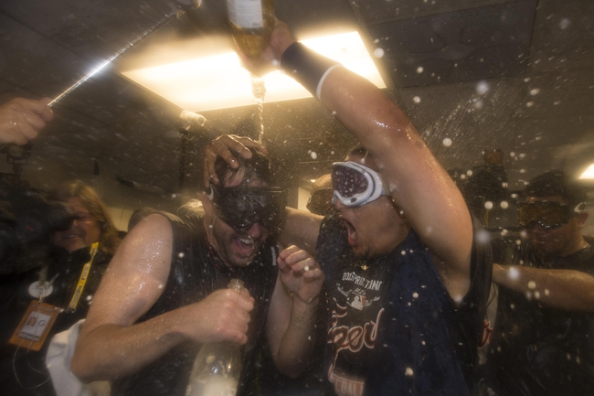October 10, 2013; Oakland, CA, USA; Detroit Tigers starting pitcher Justin Verlander (35, left) and designated hitter Victor Martinez (41, right) celebrate in the clubhouse after game five of the American League divisional series playoff baseball game against the Oakland Athletics at O.co Coliseum. The Tigers defeated the Athletics 3-0. Mandatory Credit: Kyle Terada-USA TODAY Sports
