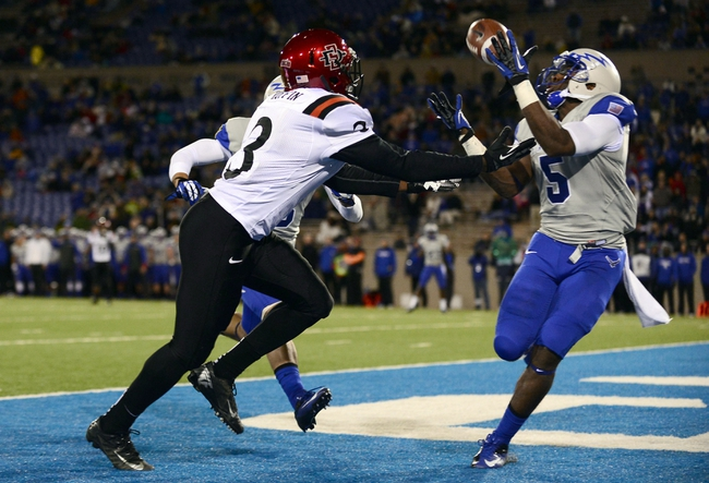 Oct 10, 2013; Colorado Springs, CO, USA; Air Force Falcons defensive back Dexter Walker (5) is unable to bring in a football intended for San Diego State Aztecs wide receiver Ezell Ruffin (3) in the third quarter at Falcon Stadium. The Aztecs defeated the Falcons 27-20. Mandatory Credit: Ron Chenoy-USA TODAY Sports