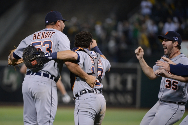October 10, 2013; Oakland, CA, USA; Detroit Tigers relief pitcher Joaquin Benoit (53, left), catcher Alex Avila (13, center), and starting pitcher Justin Verlander (35) celebrate after game five of the American League divisional series playoff baseball game against the Oakland Athletics at O.co Coliseum. The Tigers defeated the Athletics 3-0. Mandatory Credit: Kyle Terada-USA TODAY Sports