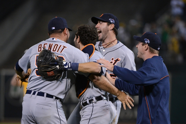 October 10, 2013; Oakland, CA, USA; Detroit Tigers relief pitcher Joaquin Benoit (53, far left), catcher Alex Avila (13, second from left), starting pitcher Justin Verlander (35, second from right), and starting pitcher Max Scherzer (37, far right) celebrate after game five of the American League divisional series playoff baseball game against the Oakland Athletics at O.co Coliseum. The Tigers defeated the Athletics 3-0. Mandatory Credit: Kyle Terada-USA TODAY Sports