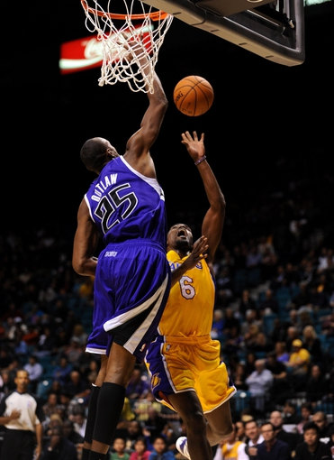 Oct 10, 2013; Las Vegas, NV, USA; Sacramento Kings forward Travis Outlaw (25) leaps to block a scoring attempt by Los Angeles Kings guard Darius Johnson-Odom (6) during an NBA preseason game at MGM Grand Arena. The Kings won the game 104-86. Mandatory Credit: Stephen R. Sylvanie-USA TODAY Sports