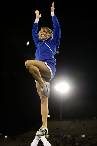 Oct 10, 2013; Colorado Springs, CO, USA; Air Force Falcons cheerleader performs in the third quarter against the San Diego State Aztecs at Falcon Stadium. The Aztecs defeated the Falcons 27-20. Mandatory Credit: Ron Chenoy-USA TODAY Sports